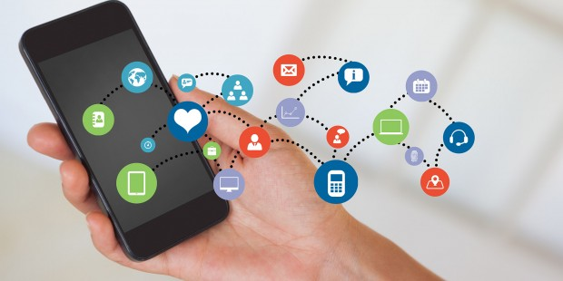 Composite image of hand holding smartphone with smartphone icons